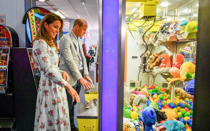 The Duke and Duchess of Cambridge playing 'grab a teddy' together in the arcade - Ben Birchall/PA