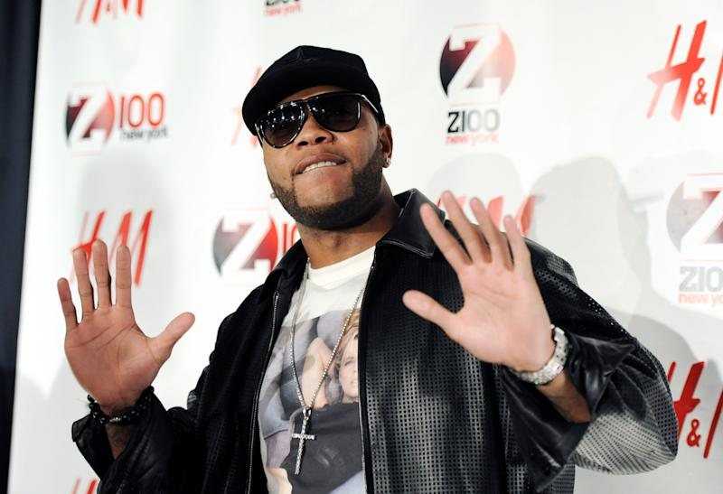 "FILE - In this Dec. 10, 2010 file photo, hip-hop artist Flo Rida attends the Z100 Jingle Ball concert at Madison Square Garden in New York. While Flo Rida has launched a number of hit singles, including ""Low,"" ""Right Round"" and ""Good Feeling,"" he hasn't had much success when it comes to album buys: His latest CD, ""Only One Flo Part 1,"" debuted at No. 107. (AP Photo/Evan Agostini, file)"
