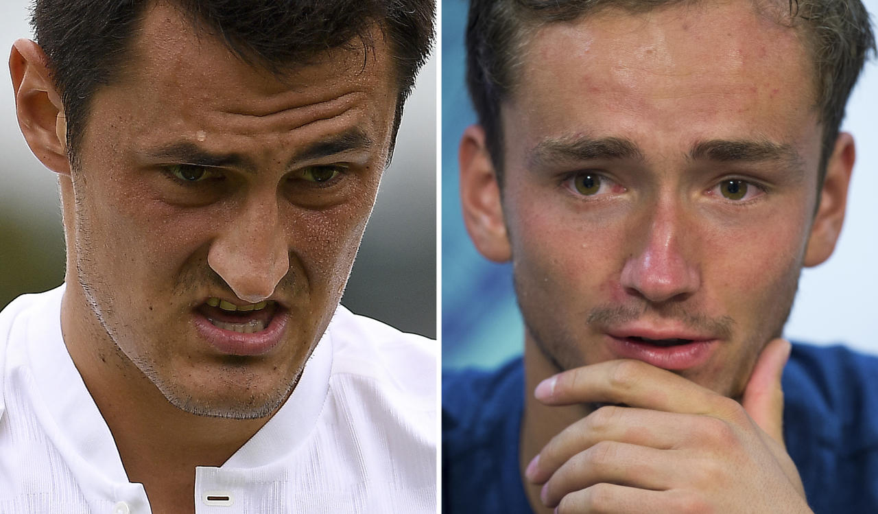 """A combination of pictures created in Wimbledon, southwest London on July 6, 2017 shows Australia's Bernard Tomic (L) reacting during his men's singles first round match on the second day of the 2017 Wimbledon Championships at The All England Lawn Tennis Club in Wimbledon, southwest London, on July 4, 2017 and Russia's Daniil Medvedev (R) speaking during a press conference after losing his second round match on the third day of the Championships. Wimbledon bad boys Bernard Tomic and Daniil Medvedev have been fined for """"unsportsmanlike conduct"""" following their controversial behaviour at the All England Club. Tomic was hit with a £11,600 ($15,000) fine after the temperamental Australian claimed he was """"bored"""" during his lacklustre Wimbledon first round defeat and Russian world number 49 Medvedev was slapped with a £11,200 ($14,500) fine after a series of disputes with umpire Mariana Alves during his five-set loss to Ruben Bemelmans in the second round. (AFP Photo/Justin TALLIS, Joe TOTH)"""