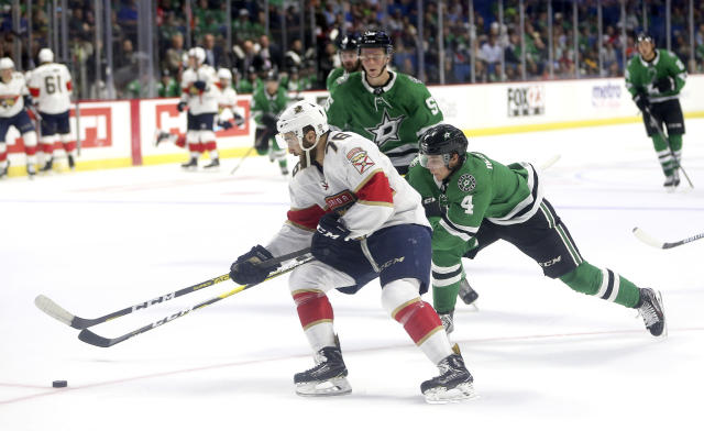 Florida Panthers' Anthony Greco attacks the net while scoring Florida's third goal as Dallas Stars' Miro Heiskanen defends during the second period of a preseason NHL hockey game in Tulsa, Okla., Saturday, Sept. 21, 2019. (AP Photo/Dave Crenshaw)