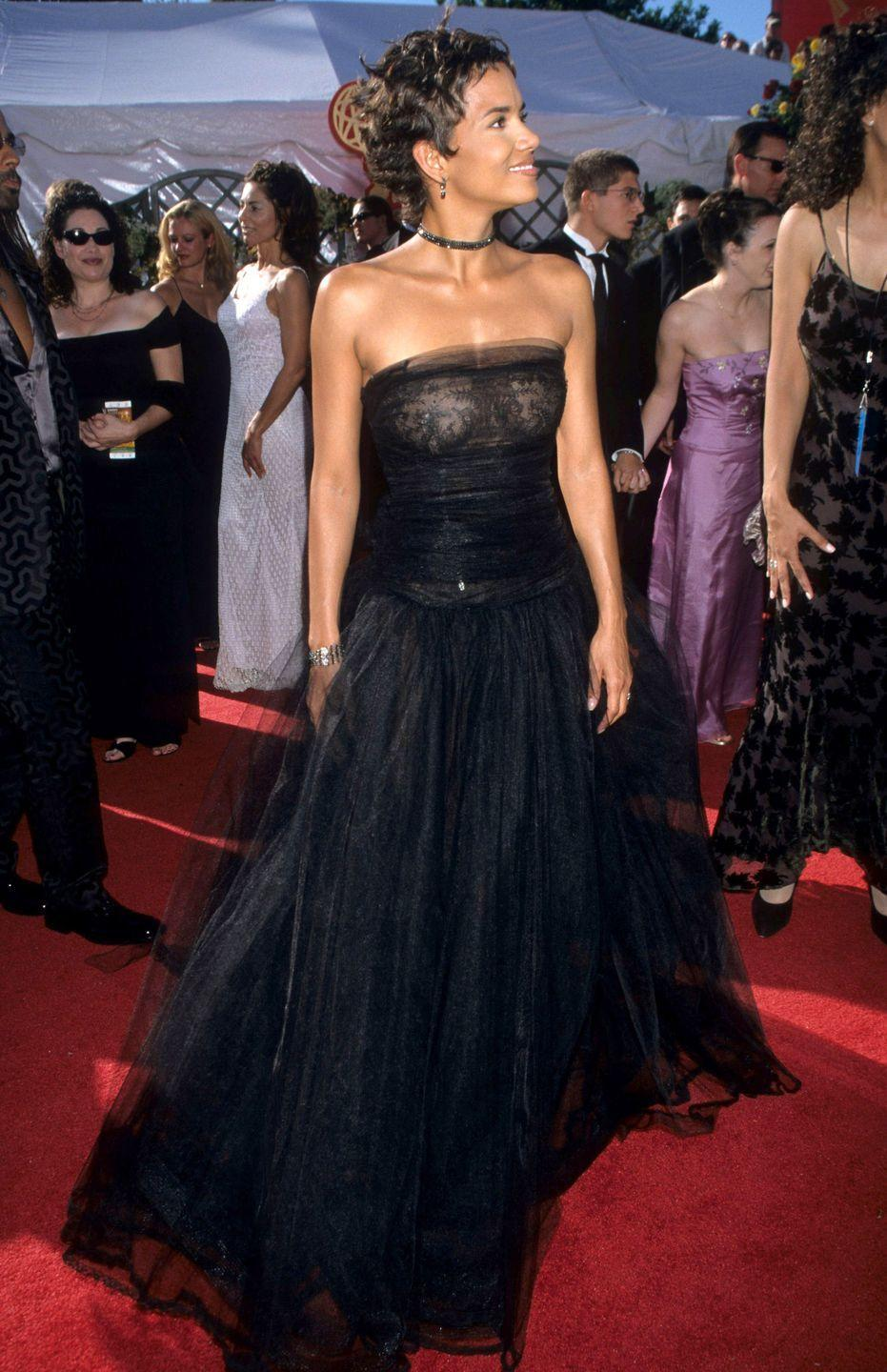 <p>This strapless tulle gown that Halle wore two decades ago still looks so modern and stylish today. She accessorized with a choker and pendant earrings to complete her Emmy's ensemble. </p>