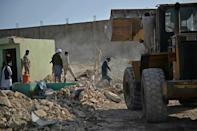 Security personnel and rescuers arrive at the site of a bomb blast in Afghanistan's Herat province on April 1, 2021.