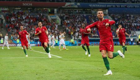 Portugal's Cristiano Ronaldo celebrates scoring their third goal with team mates REUTERS/Hannah McKay