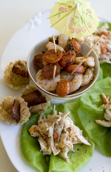 This Nov. 18, 2013 photo shows roasted shrimp cocktail, pinapple chicken lettuce wraps, and Elvis phyllo cups in Concord, N.H. (AP Photo/Matthew Mead)