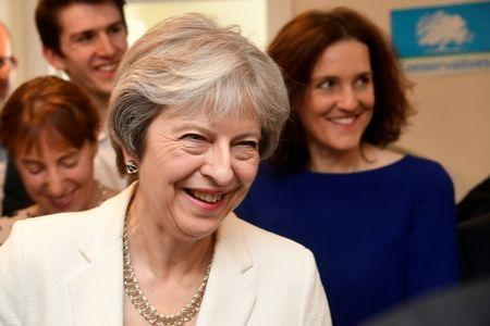 Britain's Prime Minister Theresa May speaks to supporters during a visit to Finchley Conservatives in Barnet, London
