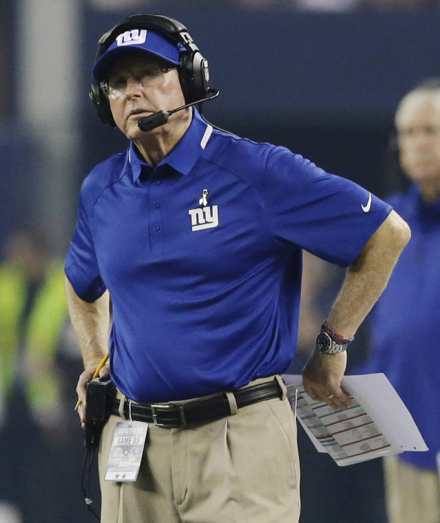 New York Giants head coach Tom Coughlin watches action against the Dallas Cowboys during the first half of an NFL football game, Sunday, Sept. 8, 2013, in Arlington, Texas. (AP Photo/LM Otero)