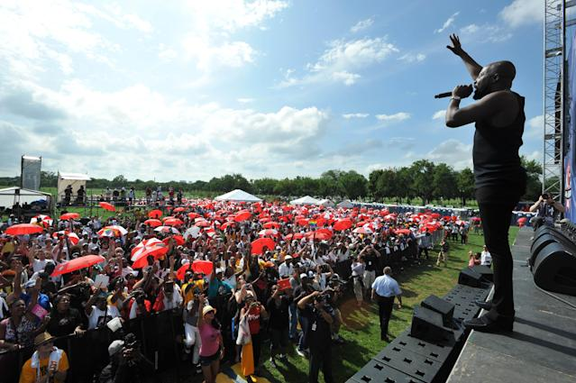 Wyclef Jean, right, performs at the Keep the Promise March on Washington and rally, Sunday, July 22, 2012, in Washington. (Photo by Larry French/AP Images for AIDS Healthcare Foundation)