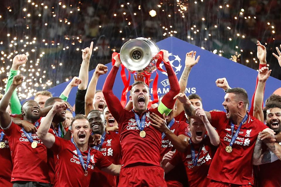 Soccer Football - Champions League Final - Tottenham Hotspur v Liverpool - Wanda Metropolitano, Madrid, Spain - June 1, 2019  Liverpool's Jordan Henderson celebrates with the trophy and teammates after winning the Champions League Final  REUTERS/Carl Recine     TPX IMAGES OF THE DAY