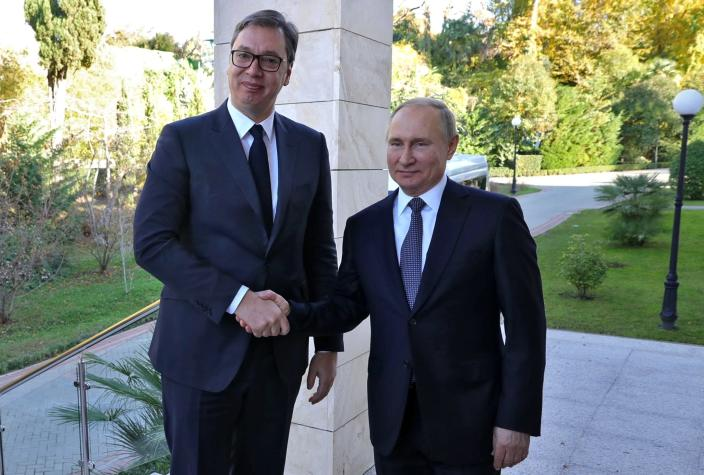 Russian President Vladimir Putin, right, and Serbian President Aleksandar Vucic pose for a photo during their meeting in the Bocharov Ruchei residence in the Black Sea resort of Sochi, Russia, Wednesday, Dec. 4, 2019.(Mikhail Klimentyev, Sputnik, Kremlin Pool Photo via AP)