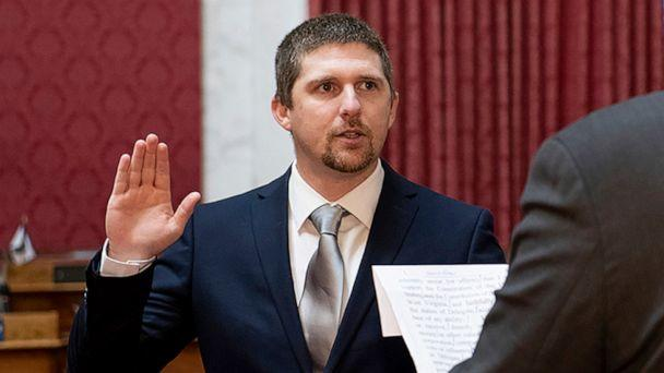 PHOTO: West Virginia House of Delegates member Derrick Evans is given the oath of office in the House chamber at the state Capitol in Charleston, W.Va., Dec. 14, 2020. (Perry Bennett/West Virginia Legislature via AP)