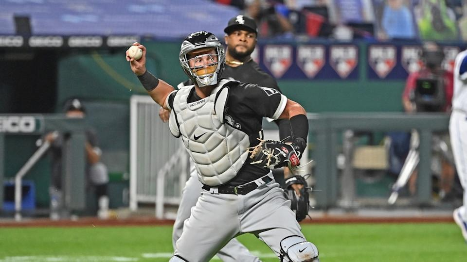 James McCann makes throw to first in White Sox catcher's gear
