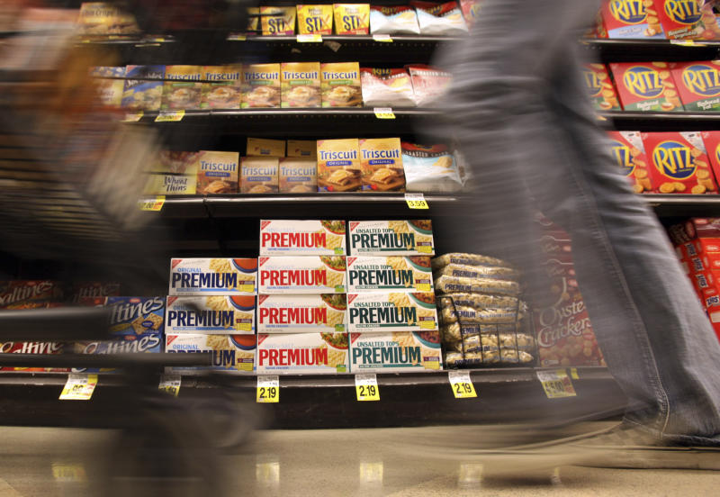 FILE - In this Feb. 9, 2011, file photo, a shopper passes a shelf of crackers and other items at a Ralphs Fresh Fare supermarket in Los Angeles. The supermarket is one of the most important places to be shopping-savvy. The good news is that there are so many easy and effective way to slash your grocery budget. (AP Photo, File)