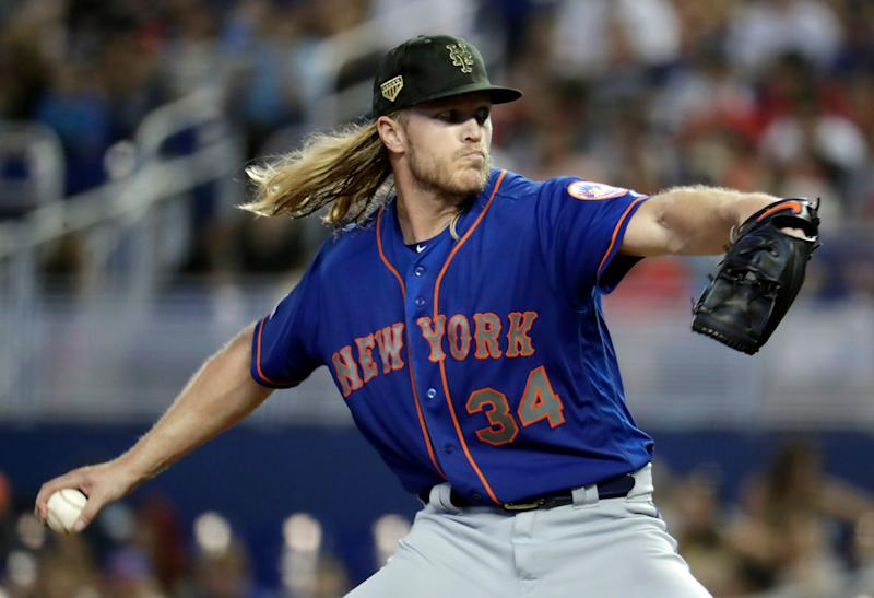 New York Mets starting pitcher Noah Syndergaard throws in the fourth inning of a baseball game against the Miami Marlins, Sunday, May 19, 2019, in Miami. (AP Photo/Lynne Sladky)