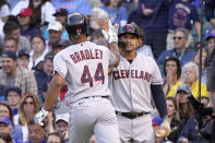 Cleveland Indians' Bobby Bradley (44) celebrates his home run off Chicago Cubs starting pitcher Albert Alzolay with Josh Naylor, right, during the second inning of a baseball game Monday, June 21, 2021, in Chicago. (AP Photo/Charles Rex Arbogast)