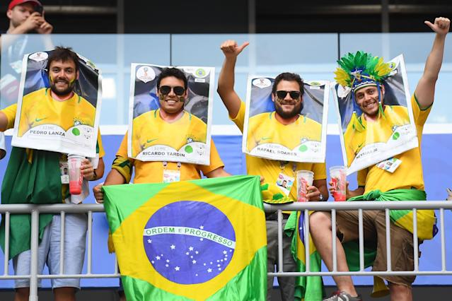 <p>Brazil's fans cheer prior to the Russia 2018 World Cup round of 16 football match between Brazil and Mexico at the Samara Arena in Samara on July 2, 2018. (Photo by MANAN VATSYAYANA / AFP) </p>