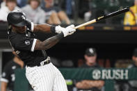 Chicago White Sox's Tim Anderson hits an RBI single during the eighth inning of the team's baseball game against the Cleveland Indians in Chicago, Friday, July 30, 2021. (AP Photo/Nam Y. Huh)