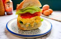 """<p>Let's be honest, egg salad can be hit or miss. If you overdo the mayo, it gets soggy. Not enough mayo and it's too dry and eggy. Luckily, here's a combination everyone can agree on. Avocado makes the <a href=""""https://www.thedailymeal.com/cook/how-hard-boil-eggs-and-peel-them-perfectly-every-time?referrer=yahoo&category=beauty_food&include_utm=1&utm_medium=referral&utm_source=yahoo&utm_campaign=feed"""" rel=""""nofollow noopener"""" target=""""_blank"""" data-ylk=""""slk:hard boiled egg"""" class=""""link rapid-noclick-resp"""">hard boiled egg</a> mixture perfectly creamy and the sriracha gives it a notable yet subtle kick.</p> <p><a href=""""https://www.thedailymeal.com/spicy-egg-salad-recipe?referrer=yahoo&category=beauty_food&include_utm=1&utm_medium=referral&utm_source=yahoo&utm_campaign=feed"""" rel=""""nofollow noopener"""" target=""""_blank"""" data-ylk=""""slk:For the Sriracha Avocado Egg Salad Sandwich recipe, click here."""" class=""""link rapid-noclick-resp"""">For the Sriracha Avocado Egg Salad Sandwich recipe, click here.</a></p>"""