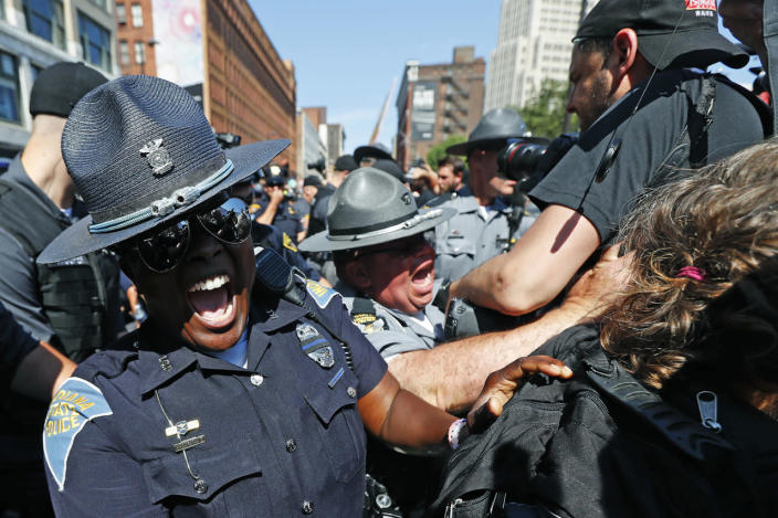 <p>Law enforcement officers clash with protesters, July 20, 2016, in Cleveland, during the third day of the Republican convention. (Photo: John Minchillo/AP)</p>