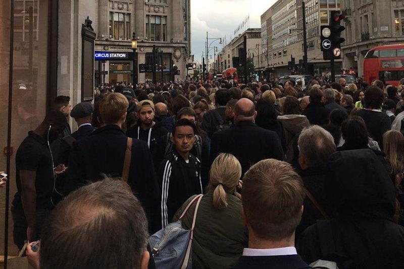 Delays: Crowds outside Oxford Circus station after the Victoria Line was suspended: @KrisIngham1