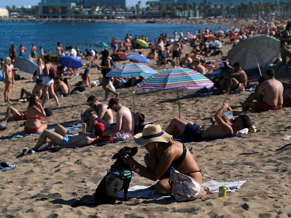 Sunbathers pack onto Barceloneta beach in Catalonia: REUTERS