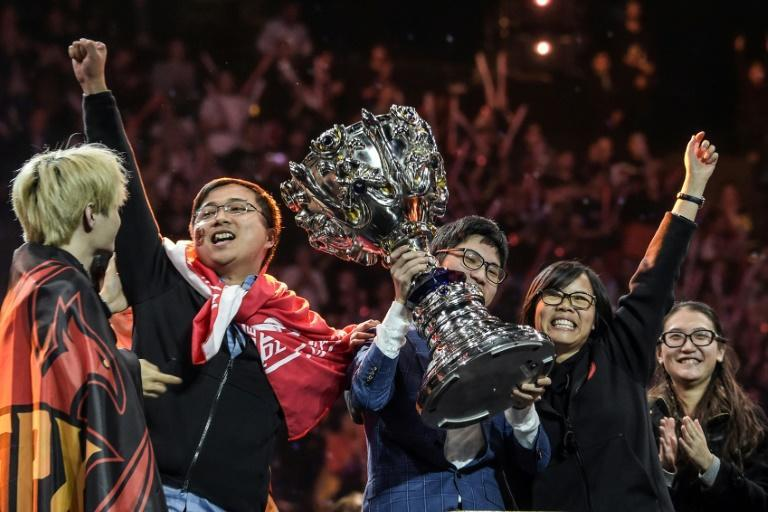 China's FPX celebrate winning the 2019 League of Legends world final in Paris