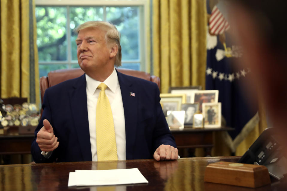 President Donald Trump listens he meets with Chinese Vice Premier Liu He in the Oval Office of the White House in Washington, Friday, Oct. 11, 2019. (AP Photo/Andrew Harnik)