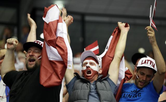 Ice Hockey - 2018 IIHF World Championships - Group B - Latvia v Denmark - Jyske Bank Boxen - Herning, Denmark - May 15, 2018 - Team Latvia fans cheer. REUTERS/David W Cerny