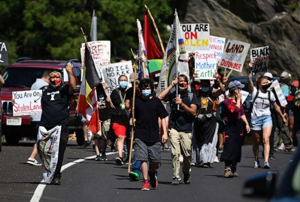 PHOTO: Activists and members of different Native American tribes from the region protest in Keystone, South Dakota on July 3, 2020, near Mount Rushmore ahead of the July 4th celebration with President Donald Trump. (Andrew Caballero-reynolds/AFP via Getty Images)