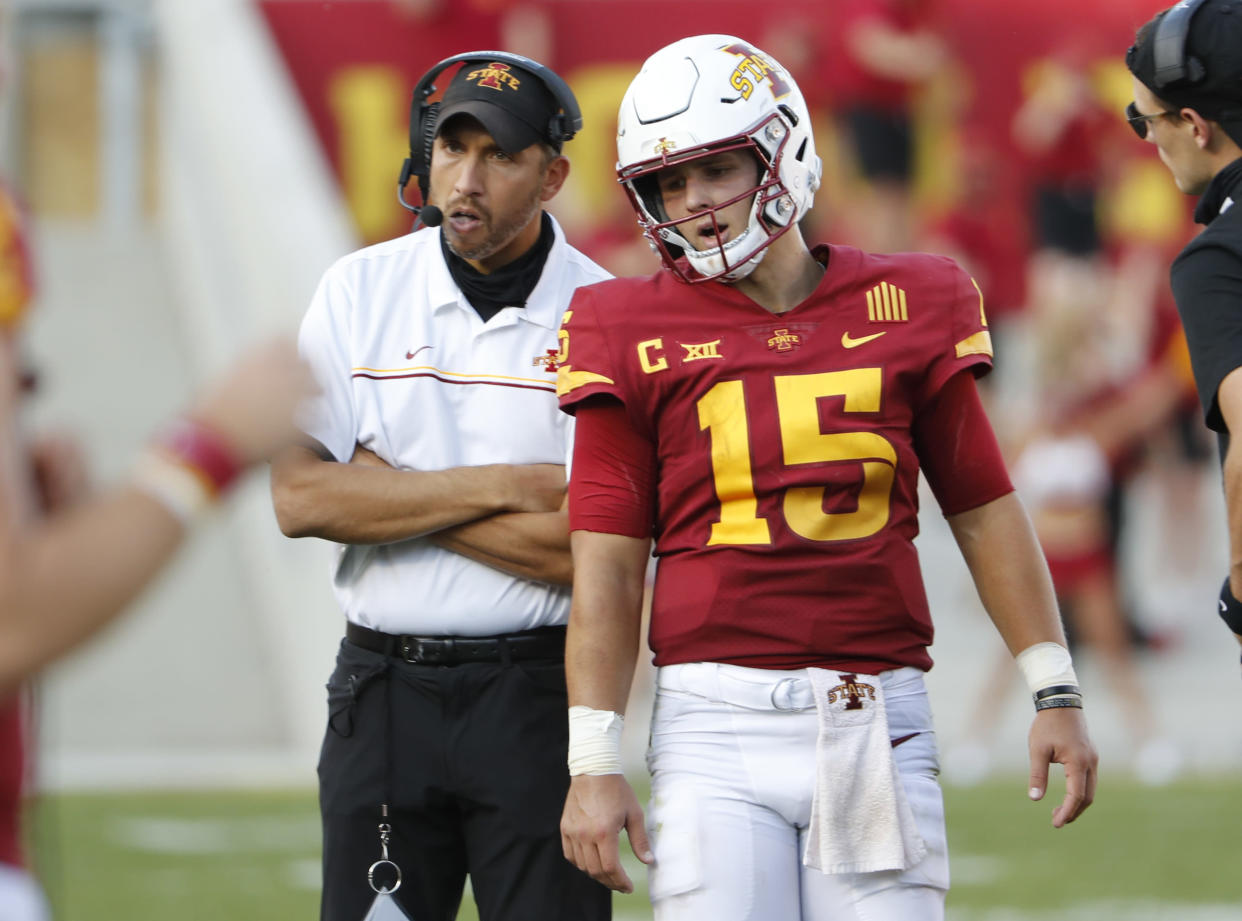 AMES, IA - OCTOBER 10: Head coach Matt Campbell of the Iowa State Cyclones talks with quarterback Brock Purdy #15 of the Iowa State Cyclones during a time out in the second half of the play at Jack Trice Stadium on October 10, 2020 in Ames, Iowa. The Iowa State Cyclones won 31-15 over the Texas Tech Red Raiders. (Photo by David Purdy/Getty Images)