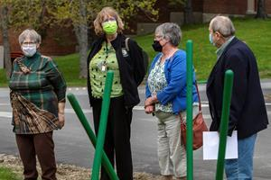 Participating in this year's retiree tree planting ceremony at Husson University were (from left to right) Priscilla Bisher, MS, RN-BC, an instructor in the School of Nursing, Laurie Eddy, MSN, RN, FNP - BC, WHCNP, an assistant professor at the Wellness Center, Janice Clark, an administrative coordinator for Athletics and Robert A. Clark, PhD, CFA, president of Husson University.