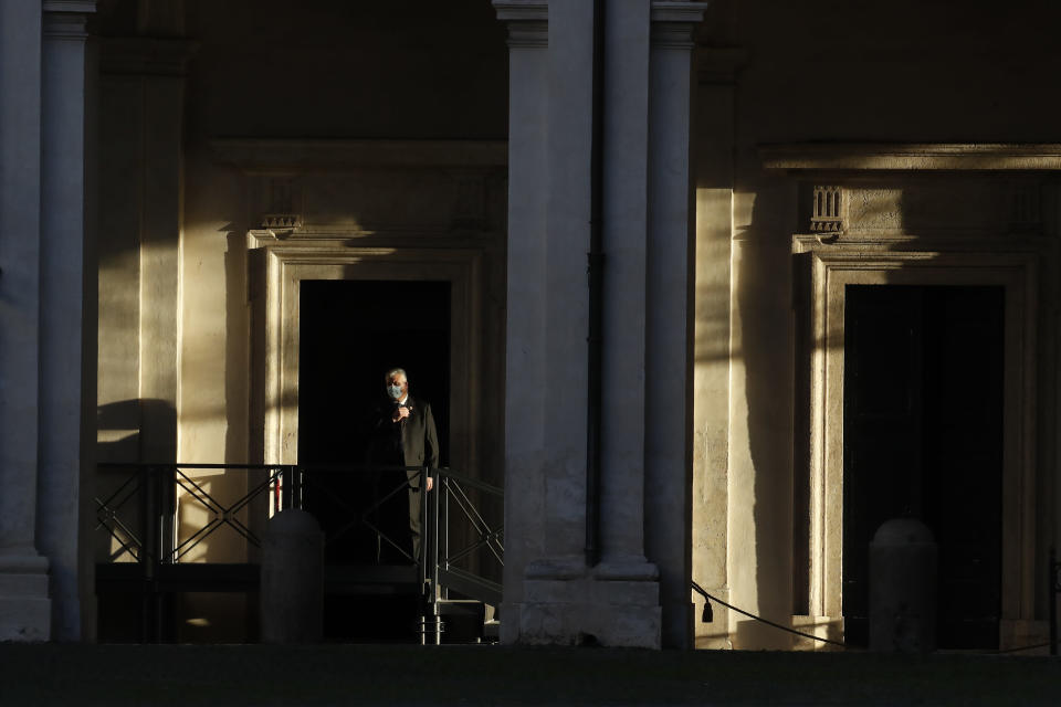 A man stands by the Quirinale presidential palace in Rome, Wednesday, Jan. 27, 2021. Italian Premier Giuseppe Conte resigned after a key coalition ally pulled his party's support over Conte's handling of the coronavirus pandemic, setting the stage for consultations this week to determine if he can form a third government. (AP Photo/Alessandra Tarantino)