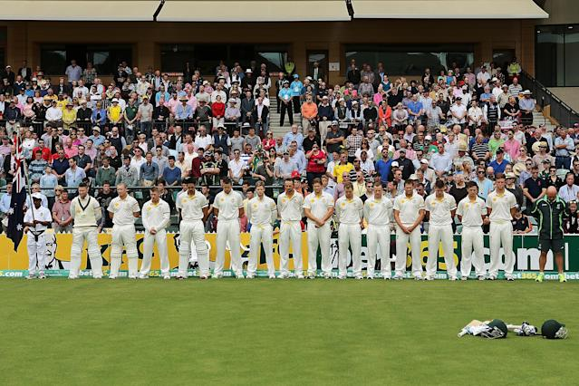 ADELAIDE, AUSTRALIA - DECEMBER 06: A minutes silence is observed by the Australian squad at the Adelaide Oval as a mark of respect for Nelson Mandela during day two of the Second Ashes Test Match between Australia and England at Adelaide Oval on December 6, 2013 in Adelaide, Australia. (Photo by Morne de Klerk/Getty Images)
