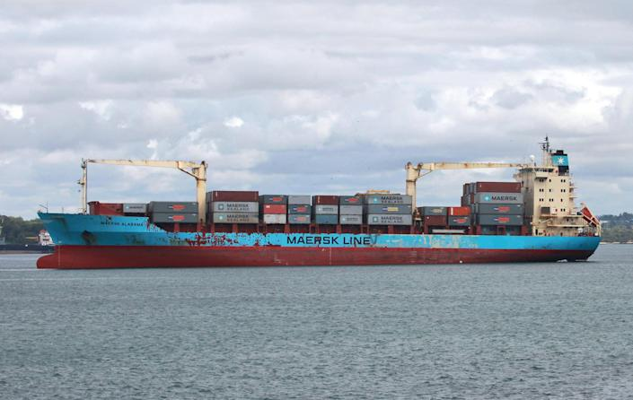 """FILE - In this April 22, 2009 file photo, the U.S.-flagged Maersk Alabama leaves the port of Mombasa, in Kenya. Police in the Indian Ocean island nation of Seychelles said Wednesday, Feb. 19, 2014 that two American security officers were found dead Tuesday in a cabin on the Maersk Alabama, the ship hijacked by pirates in 2009, an event dramatized in the movie """"Captain Phillips"""" starring Tom Hanks. (AP Photo/Sayyid Azim, File)"""