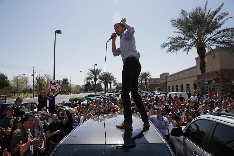 Democratic presidential candidate and former Texas congressman Beto O'Rourke speaks from the roof of his car to an overflow crowd at a campaign stop at a coffee shop Sunday, March 24, 2019, in Las Vegas. (AP Photo/John Locher)