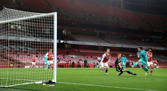 Diogo Jota fires home Liverpool's third goal in their 3-0 Premier League win against Arsenal at the Emirates Stadium