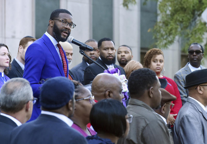 """Birmingham Mayor Randall Woodfin speaks at a candlelight vigil for Kamille """"Cupcake"""" McKinney in Linn Park in front of Birmingham City Hall, Wednesday, Oct. 23, 2019, in Birmingham, Ala. Police say they will charge two people with kidnapping and capital murder in the death of the 3-year-old Alabama girl whose body was found amid trash 10 days after being kidnapped outside a birthday party. (Joe Songer/The Birmingham News via AP)"""