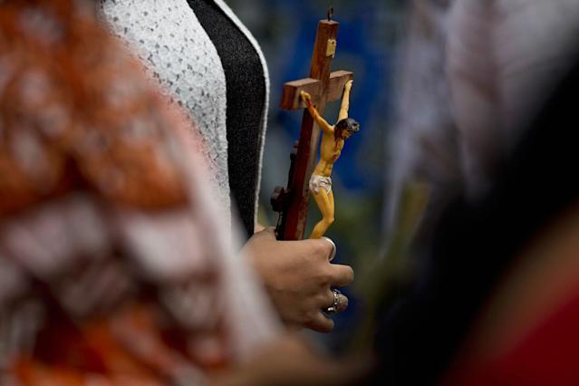 <p>An Indian Christian hold a crucifix during a Good Friday procession in Hyderabad, India, Friday, March 30, 2018. (Photo: Mahesh Kumar A./AP) </p>