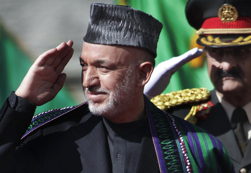 In this Thursday, Nov. 19, 2009, photo, Afghanistan's President Hamid Karzai saluting the guards of honor as he arrives to the Presidential Palace for his inauguration in Kabul, Afghanistan. Considered critical to peace in Afghanistan, Pakistan late last year accepted a request from Afghanistan's High Peace Council to free several Afghan Taliban prisoners. So far, 24 Taliban have been released. The release was meant to be a good will gesture to coax a reluctant Taliban leadership to negotiate directly with Afghan President Hamid Karzai's Afghan High Peace Council. (AP Photo/Anja Niedringhaus)