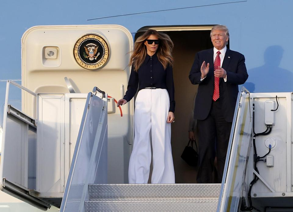 """<p>The host Japanese Prime Minister Shinzo Abe and his wife Akie Abe, the Trumps invited the couple to their Mar-a-Lago estate for the weekend. For the trip from Andrews Air Force Base in Md. to Palm Beach, Fla., Melania Trump dressed in a fashionable yet comfortable ensemble from Michael Kors. The FLOTUS paired white wide-legged pants with a black blouse and matching black wool coat that she casually draped over her shoulders. When previously asked about dressing the first lady, <span>Kors said</span>, """"That's none of my business."""" Melania previously wore Michael Kors on election day in November when she went to cast her vote in New York City. (Photo: AP) </p>"""