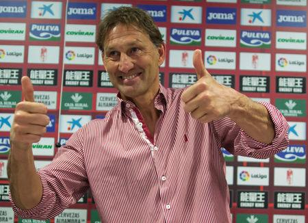 Former Arsenal and England captain Adams reacts after being presented as new head coach of Granada soccer club, in Granada