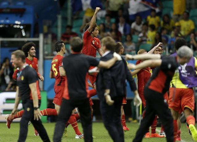 Belgium players celebrates after Kevin De Bruyne scored his side's first goal in extra time during the World Cup round of 16 soccer match between Belgium and the USA at the Arena Fonte Nova in Salvador, Brazil, Tuesday, July 1, 2014. (AP Photo/Natacha Pisarenko)