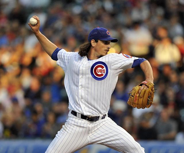 Chicago Cubs' Jeff Samardzija pitches against the Cincinnati Reds during the first inning of a baseball game Tuesday, Aug. 13, 2013, in Chicago. (AP Photo/Jim Prisching)