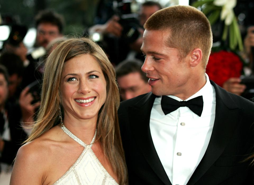 US ACTOR PITT ESCORTS WIFE US ACTRESS JENNIFER ANISTON FOR THE SCREENING OF 'TROY' AT THE 57TH CANNES FILM FESTIVAL.  U.S. Actor Brad Pitt (L) escorts his wife U.S. actress Jennifer Aniston (R) during red carpet arrivals for the screening of German director Wolfang Petersen's 'Troy' at the 57th Cannes Film Festival, May 13, 2004. REUTERS/Eric Gaillard PP05010029