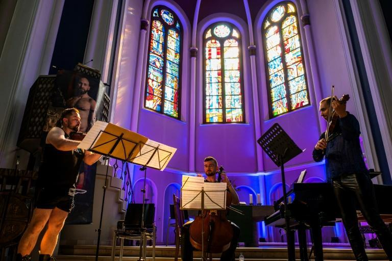 The musicians, among them an organist and a violinist, all follow the dress code (AFP/John MACDOUGALL)
