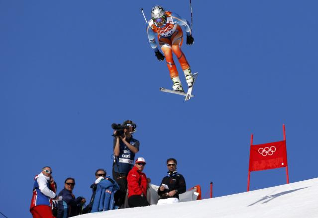 Norway's Aksel Lund Svindal goes airborne during the downhill run of the men's alpine skiing super combined event at the 2014 Sochi Winter Olympics at the Rosa Khutor Alpine Center February 14, 2014. REUTERS/Stefano Rellandini (RUSSIA - Tags: SPORT SKIING OLYMPICS)