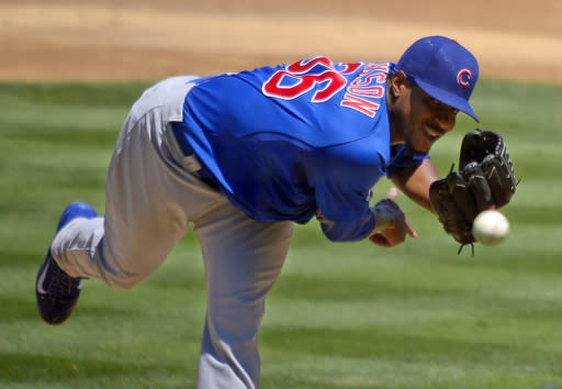 Chicago Cubs starting pitcher Edwin Jackson throws to the plate during the second inning of a baseball game against the Los Angeles Dodgers, Wednesday, Aug. 28, 2013, in Los Angeles. (AP Photo/Mark J. Terrill)