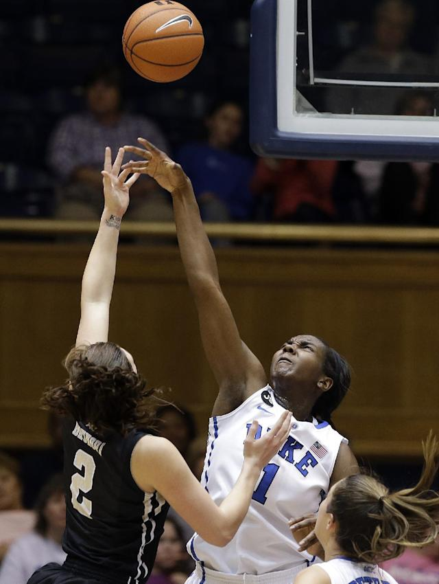 Duke's Elizabeth Williams blocks Wake Forest's Jill Brunori (2) during the first half of an NCAA college basketball game in Durham, N.C., Thursday, Feb. 27, 2014. (AP Photo/Gerry Broome)