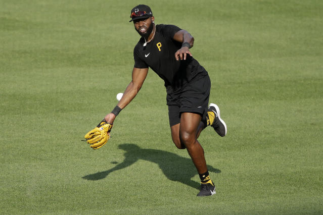 Pittsburgh Pirates right fielder Gregory Polanco can't come up with the ball as he shags fly balls in right field during batting practice at PNC Park during baseball practice in Pittsburgh, Wednesday, July 8, 2020. (AP Photo/Gene J. Puskar)