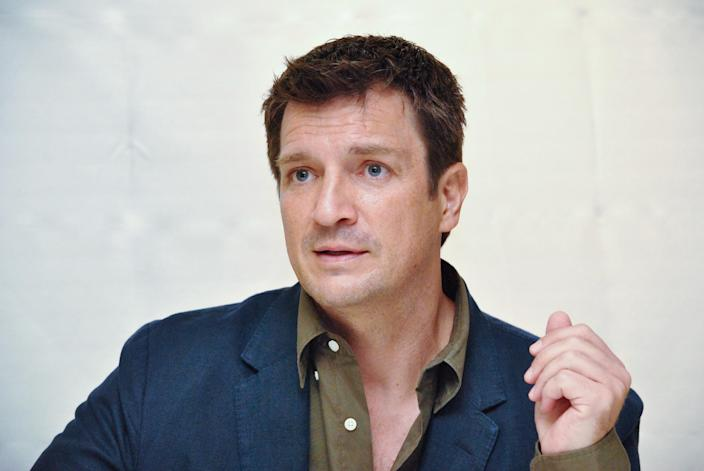 "Nathan Fillion at the Hollywood Foreign Press Association press conference for ""The Rookie"" at the Four Seasons Hotel on September 18, 2018 in Beverly Hills, California. (Photo by Yoram Kahana/Shooting Star/Sipa USA)"