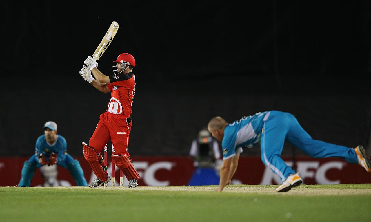 MELBOURNE, AUSTRALIA - DECEMBER 22: Ben Rohrer of the Renegades hits the ball off the bowling of James Hopes of the Heat during the Big Bash League match between the Melborune Renegades and the Brisbane Heat at Etihad Stadium on December 22, 2012 in Melbourne, Australia.  (Photo by Michael Dodge/Getty Images)
